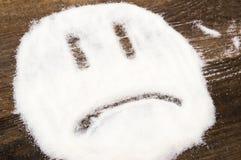 Сторона унылого smiley сделанного с раздробленным сахаром Стоковые Изображения RF