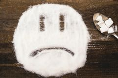 Сторона унылого smiley сделанного с раздробленным сахаром Стоковые Фото
