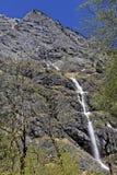 Сторона утеса с малой подачей лавины на весну Стоковые Фотографии RF