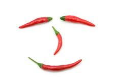 Сторона smiley перца красных чилей на белизне Стоковое Изображение RF