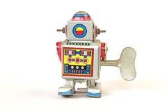 стоящий винтажный робот олова, задний взгляд с ключом Стоковое Фото