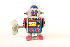 стоящий винтажный робот олова, невозмутимый вид с ключом Стоковое Изображение RF