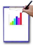 Столбчатая диаграмма на бумаге с рукой. Стоковое Изображение RF