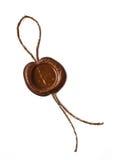 Столб штемпелюет, пустой воск уплотнения при изолированный шнур на белизне Стоковое Изображение