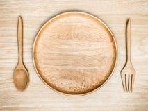 столовый прибор деревянный на деревянной предпосылке Взгляд сверху Стоковое Изображение