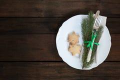Столовый прибор украшения рождества на старой деревянной коричневой предпосылке Стоковые Фото
