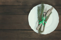 Столовый прибор украшения рождества на старой деревянной коричневой предпосылке Стоковое фото RF