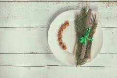 Столовый прибор украшения рождества на старой деревянной предпосылке Стоковое фото RF