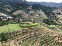 Страна Dazhai с деревнями и рисовыми полями Стоковое Фото