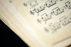 Страница старой музыкальной тетради Стоковая Фотография