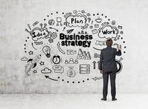 Стратегия бизнеса чертежа человека, конкретная Стоковые Изображения