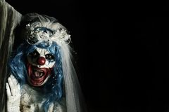 Страшный злий клоун в платье невесты Стоковое Фото
