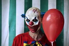 Страшный злий клоун в цирке Стоковые Фотографии RF