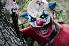 Страшный злий клоун с ножом Стоковые Фото