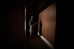Страшный ребенок с ножом Стоковое Фото