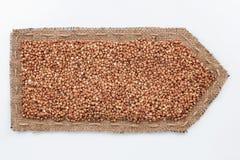 Стрелка сделанная из мешковины с зернами гречихи Стоковая Фотография RF