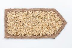 Стрелка сделанная из мешковины с зернами овса Стоковые Изображения
