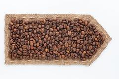 Стрелка сделанная из мешковины с кофейными зернами Стоковое Изображение