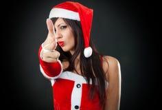 Стрельба девушки Santa Claus с рукой Стоковая Фотография RF