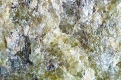 Стрельба макроса естественной драгоценной камня Текстура минерального оливина абстрактная предпосылка Стоковое Изображение