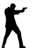 Стрельба человека силуэта полнометражная с пушкой Стоковое Изображение RF