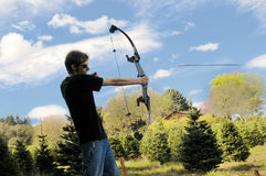 стрельба человека смычка стрелки Стоковое Изображение