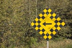 Стрелка знака предосторежения дороги левая Стоковая Фотография