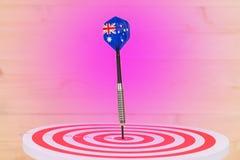 Стрелка дротиков с Австралией сигнализирует на доске дротика Стоковые Изображения