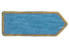 Стрелка сделанная из джинсовой ткани с желтыми стразами, изолированный Стоковое Изображение