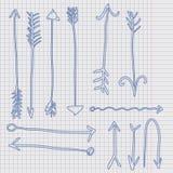 Стрелка Doodle на листе клетки Стоковое Изображение