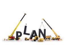 Строение вверх по плану: Машины строя план-слово. Стоковые Изображения RF