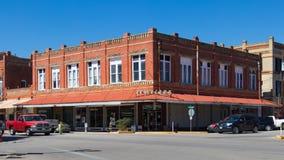 Строение здания рассказа красного кирпича 2 около поворота двадцатого c Стоковая Фотография
