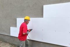 Строительная площадка, изоляция стиропора сверля для анкера Стоковые Изображения RF