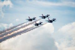 Строй ромб буревестников над облаками Стоковые Фотографии RF