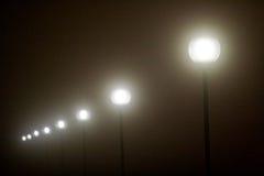 Строка лампы вывешивает накалять в темноте Стоковые Изображения RF