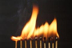 Строка горящих спичек Стоковая Фотография