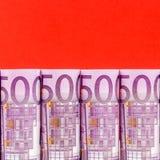 строка евро 500 на красной предпосылке Стоковая Фотография RF