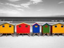 Строка деревянных ярко покрашенных хат Стоковое Изображение RF