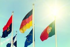 Строка национальных флагов против голубого неба Стоковая Фотография RF