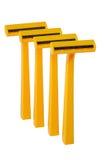 Строка оранжевых бритв безопасности Стоковые Изображения