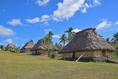 Строка фиджийского bure в Navala, деревня в гористых местностях ба северного центрального Viti Levu, Фиджи Стоковые Фото