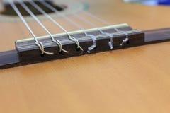Строки гитары на стойке Стоковое Изображение