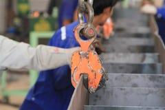 Струбцина плиты поднимаясь оборудования Стоковое фото RF
