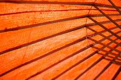 Структура крупного плана деревянная оранжевой предпосылки зонтика цвета Стоковое Фото