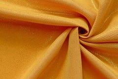 Структура ткани золотого цвета сияющая Стоковая Фотография