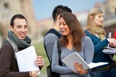 студенты группы коллежа multiracial стоковое фото rf