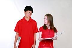 студенты девушки мальчика Стоковые Фотографии RF