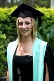 студент-выпускник счастливый к Стоковая Фотография RF