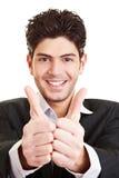 Студент держа оба большого пальца руки вверх Стоковые Фотографии RF