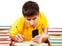 Студент с телефоном Стоковое Изображение